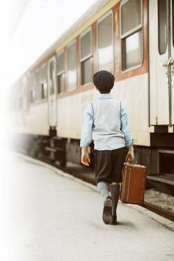 Krasimira Petrova Shishkova RETRO SCHOOL BOY WITH SUITCASE BESIDE TRAIN Children