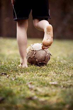Kelly Sillaste BAREFOOT BOY KICKING FOOTBALL Children