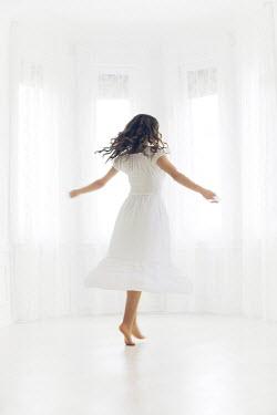 Ildiko Neer YOUNG WOMAN DANCING IN WHITE ROOM Women
