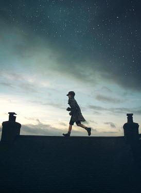 Mark Owen 1940'S BOY WALKING ON ROOFTOP Children
