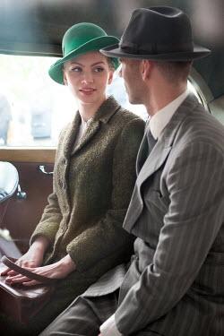 Lee Avison 1940s couple sitting inside a vintage car Couples