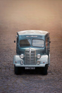 Emma Goulder VINTAGE AMBULANCE ON COBBLED STREET Miscellaneous Transport