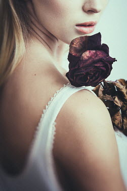 Dorota Gorecka YOUNG BLONDE WOMAN WITH DRIED ROSE Women