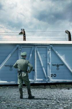 Stephen Mulcahey army officer looking at ww2 prison train Men