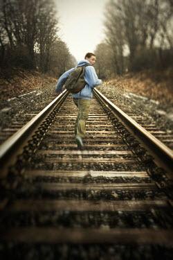 Debra Lill TEENAGE BOY RUNNING ON RAILWAY TRACKS Children
