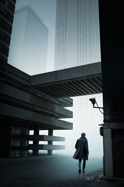 James Wragg MAN WALKING IN MODERN CONCRETE CITY Men