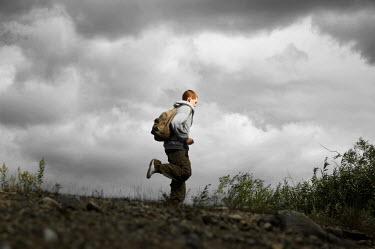 Debra Lill MODERN TEENAGE BOY RUNNING IN COUNTRYSIDE Children