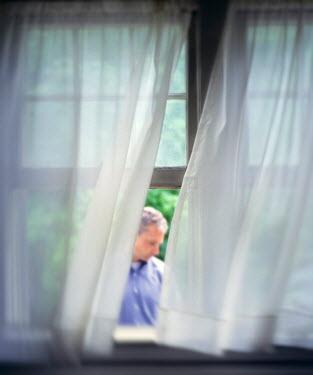 Debra Lill MAN WITH GREY HAIR OUTSIDE WINDOW Men