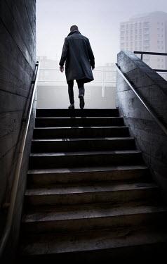 James Wragg MAN IN COAT WALKING UP CITY STEPS Men