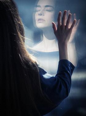 Elisabeth Ansley WOMAN WITH REFLECTION ON WINDOW Women