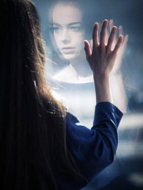 Elisabeth Ansley REFLECTION OF WOMAN IN WINDOW Women