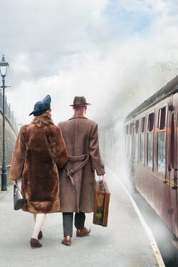 Lee Avison 1940's couple on a railway platform with steam train Couples