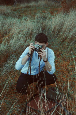 Michelle De Rose VINTAGE MAN TAKING PHOTOS IN COUNTRYSIDE Men