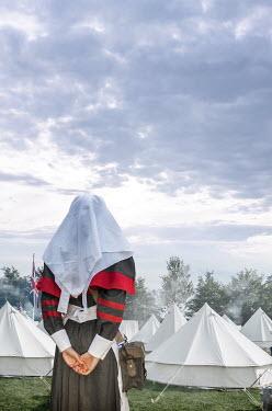 Stephen Mulcahey A ww1 nurse by tents in field hospital Women