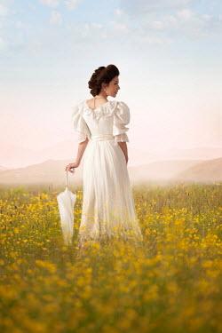 Lee Avison brunette edwardian woman in a buttercup meadow Women