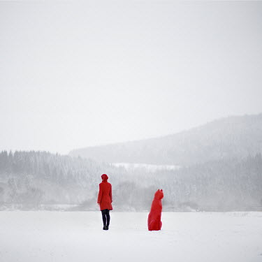 Michal Zahornacky WOMAN IN RED COAT BY CAT ORNAMENT IN SNOW Women