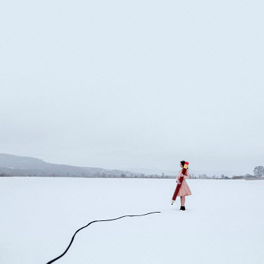 Michal Zahornacky SURREAL YOUNG WOMAN WITH GIANT PENCIL IN SNOW Women