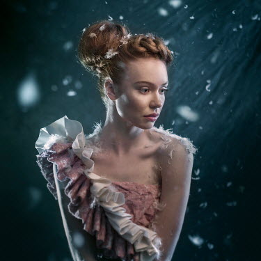 Michal Zahornacky YOUNG WOMAN WITH HAIR UP COVERED IN FEATHERS Women