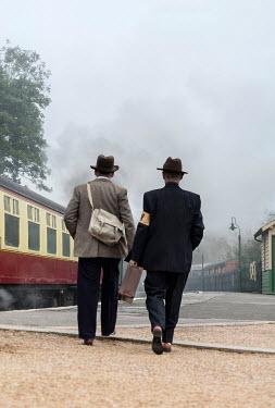 CollaborationJS two 1940s men walking on train platform Groups/Crowds