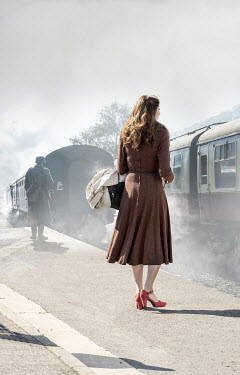 CollaborationJS brunette 1940s woman waiting at train platform Women