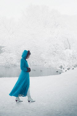 ILINA SIMEONOVA VINTAGE WOMAN WEARING BLUE COAT IN SNOWY PARK Women
