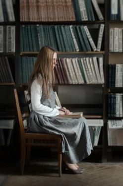 Inna Mosina RETRO GIRL SITTING WITH BOOKS Women