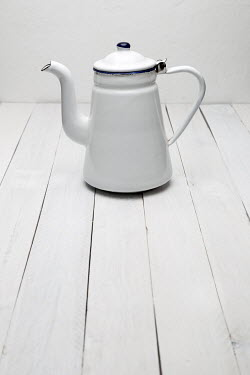Paolo Martinez WHITE ENAMEL COFFEE POT ON TABLE Miscellaneous Objects