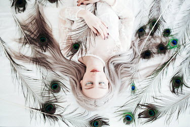 Jovana Rikalo BLONDE GIRL LYING WITH PEACOCK FEATHERS Women