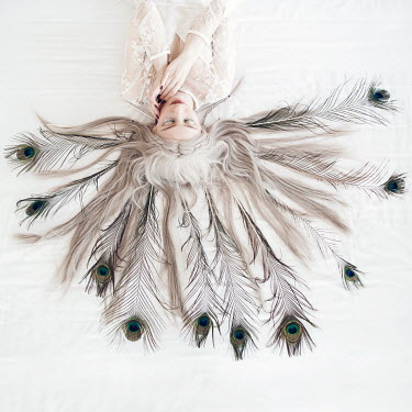 Jovana Rikalo BLONDE WOMAN LYING WITH PEACOCK FEATHERS Women