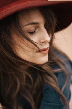 Nina Masic WOMAN DAYDREAMING IN RED HAT Women
