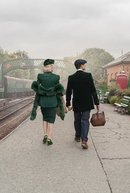 CollaborationJS 1940s couple walking along train platform Couples