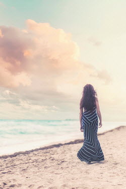 Evelina Kremsdorf WOMAN IN DRESS ON SUMMERY BEACH Women