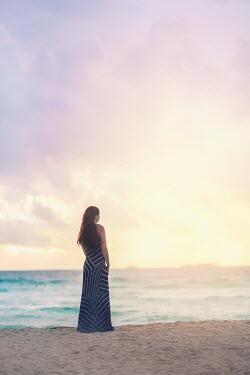 Evelina Kremsdorf WOMAN STANDING ON SUMMERY BEACH Women