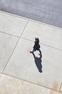 Susan Fox WOMAN WALKING ON SUNIT CONCRETE Women
