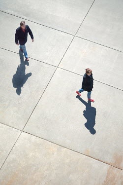 Susan Fox COUPLE WALKING ON SUNLIT CONCRETE Couples