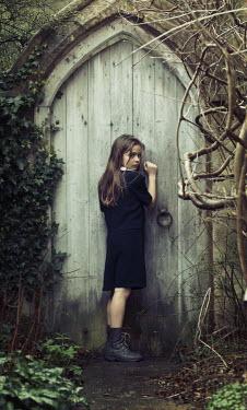 Robin Macmillan SCARED GIRL BY OLD GARDEN DOOR Children