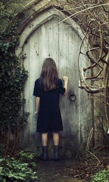 Robin Macmillan GIRL KNOCKING ON OLD GARDEN DOOR Children
