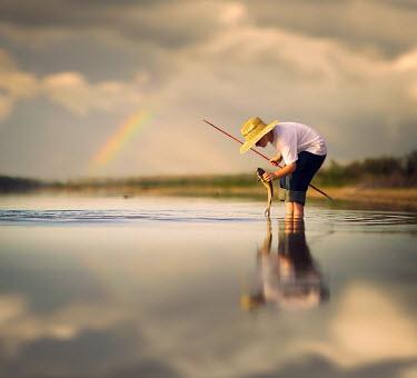 Jake Olson TEENAGER CATCHING FISH WITH RAINBOW Children