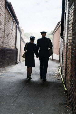 CollaborationJS silhouette of ww2 couple walking down street Couples