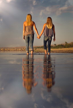 Jake Olson TWO GIRLS HOLDING HANDS IN RIVER Women