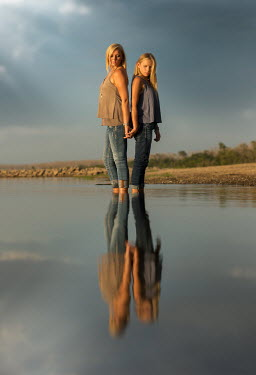 Jake Olson MOTHER AND DAUGHTER IN LAKE Women