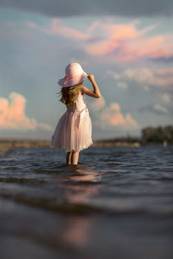 Jake Olson LITTLE GIRL WITH HAT IN LAKE Children