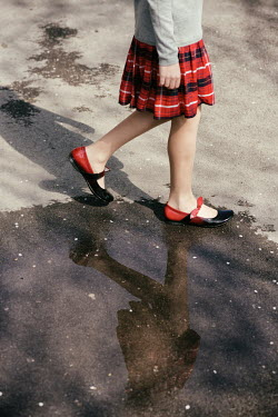 Krasimira Petrova Shishkova GIRL IN KILT WALKING IN PUDDLE Children