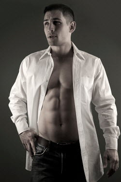 ILINA SIMEONOVA MUSCULAR MAN STANDING IN WHITE SHIRT Men