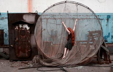 Igor Burba GIRL WITH RED HAIR HANGING ON LARGE NET Women