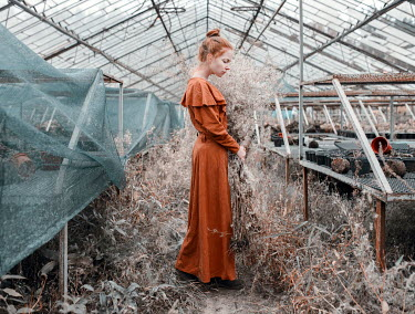 Igor Burba WOMAN STANDING IN DERELICT GREENHOUSE Women