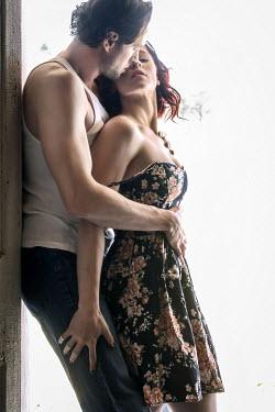 Stephen Carroll MODERN COUPLE EMBRACING IN DOORWAY Couples