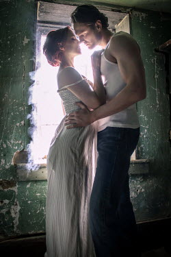 Stephen Carroll INTIMATE COUPLE EMBRACING IN DERELICT ROOM Couples