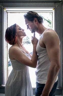 Stephen Carroll INTIMATE YOUNG COUPLE BESIDE WINDOW Couples