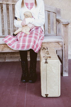 Elisabeth Ansley LITTLE GIRL WITH SUITCASE SITTING ON BENCH Children